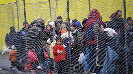 FILE PHOTO Migrants wait to cross the border from Slovenia into Spielfeld in Austria, February 16, 2016