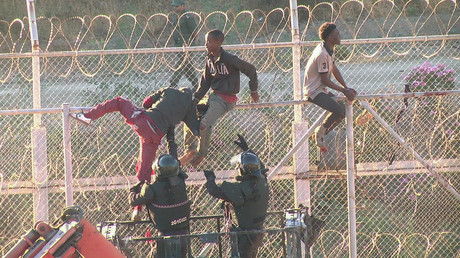 African migrants in this still image from video climb the border from Morocco to Spain's North African enclave of Ceuta, Spain, July 26, 2018