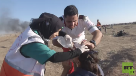 Journalist working with RT caught in tear gas attack amid deadly Gaza protests (VIDEO)