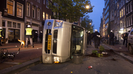 FILE PHOTO: Aan overturned car in Amsterdam © Cris Toala Olivares