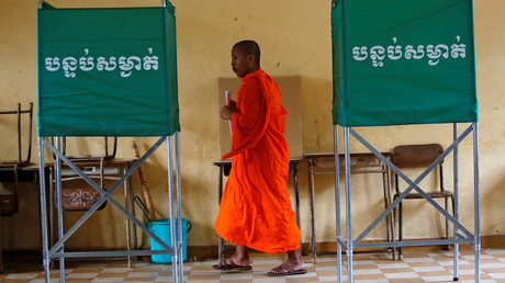 A Buddhist monk votes at a polling station during the general election in Phnom Penh, Cambodia. © Samrang Pring