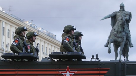 Russian servicemen are seen onboard a military vehicle in Tverskaya Street in central Moscow © Tatyana Makeyeva