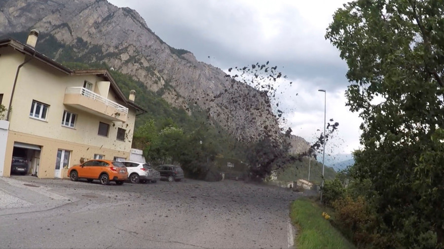 Rampaging mudslides wreak havoc in village in Swiss Alps (VIDEO)