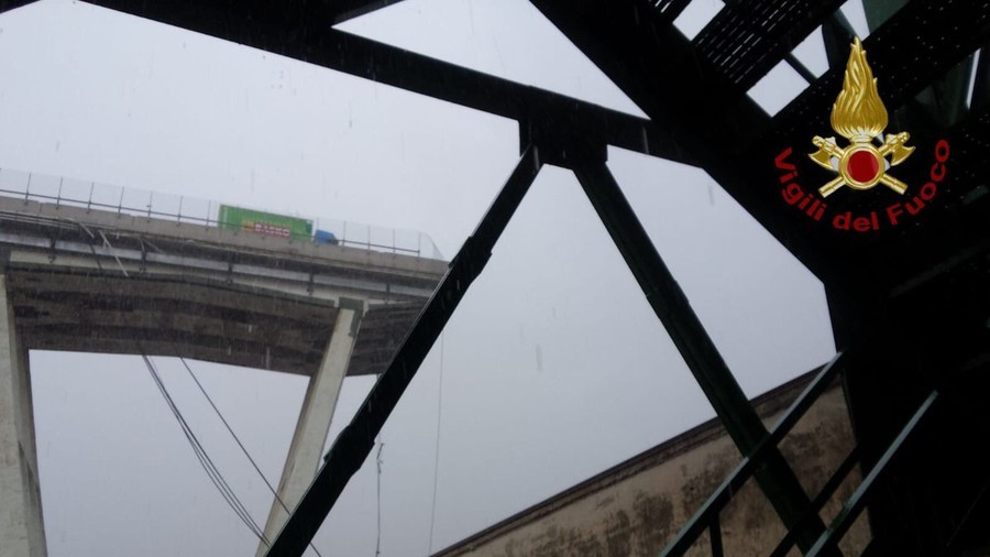 Major motorway bridge collapses in Genoa during violent storm