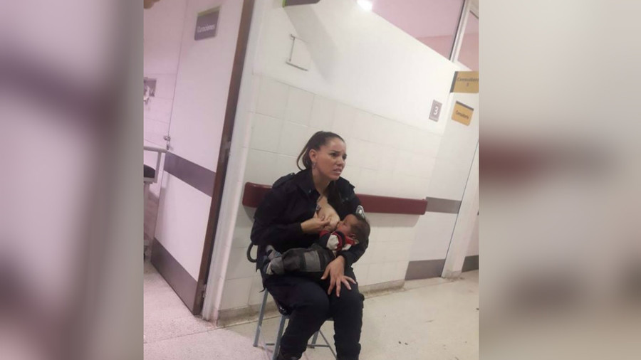 Argentinian cop breastfeeds hungry baby while hospital medics overwhelmed (PHOTO)