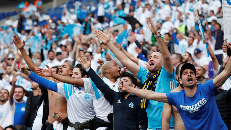 Young Marseille fan dribbles length of pitch to score from ceremonial kick-off (VIDEO)
