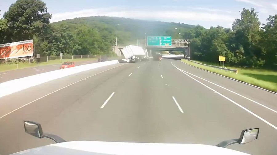 Candy crash: Bizarre motorist duel ends in shocking truck flip collision (VIDEO)