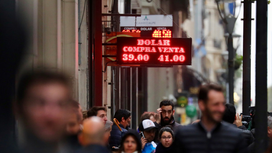 Argentina's currency collapses despite massive rate hike as possible debt default looms
