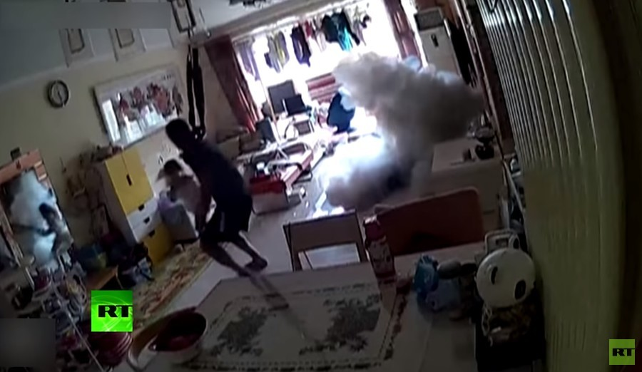 Family flee fiery scooter as charging device explodes in their home (VIDEO)