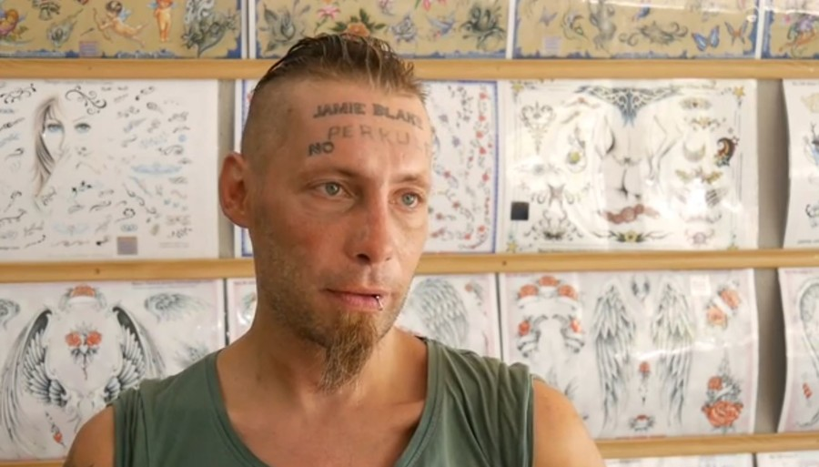 Stag party paid 'drunk and hungry' homeless man to tattoo name & postcode on forehead (VIDEO)
