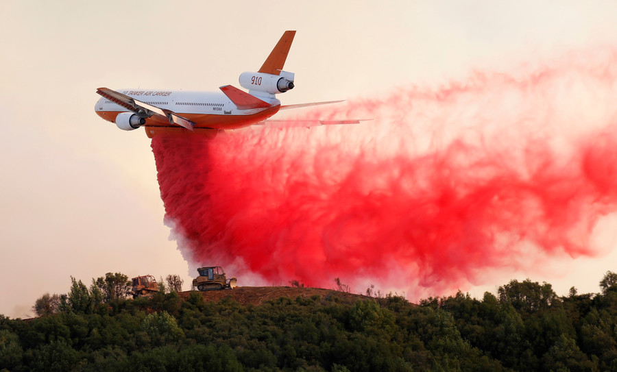 Holy smoke! Dramatic footage captures moment aircraft douses California wildfire (VIDEO)