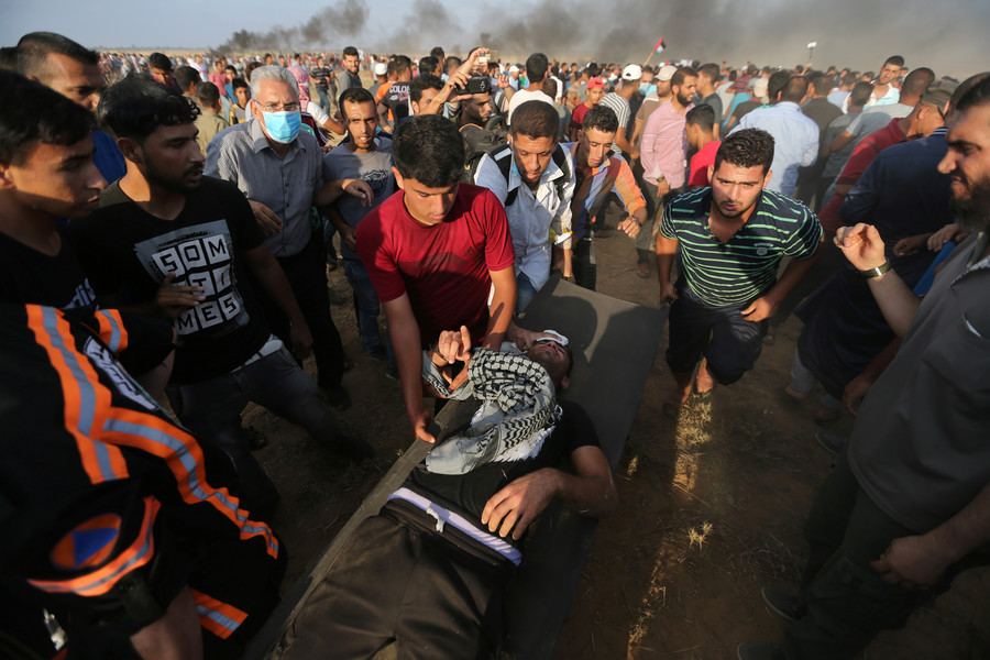 Paramedic on duty among two killed by Israeli fire in Gaza, 300+ more injured (VIDEO)