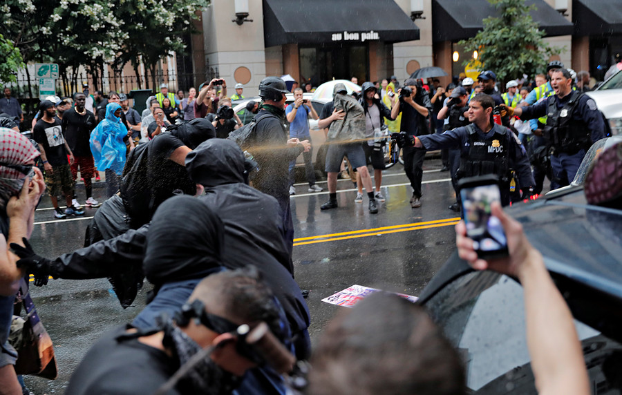 Right, left-wing groups face each other in fiery public confrontations in Boston, Seattle