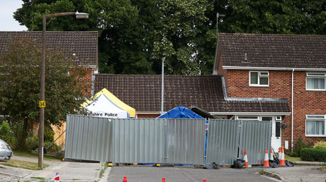 A barrier and a police tent are seen outside Sergei Skripal's home in Salisbury, UK. © Hannah Mckay / Reuters