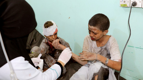 A doctor treats children injured by an airstrike in Saada, Yemen, August 9.