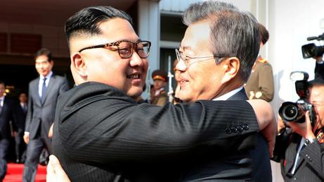 FILE PHOTO: South Korean President Moon Jae-in and North Korean leader Kim Jong Un