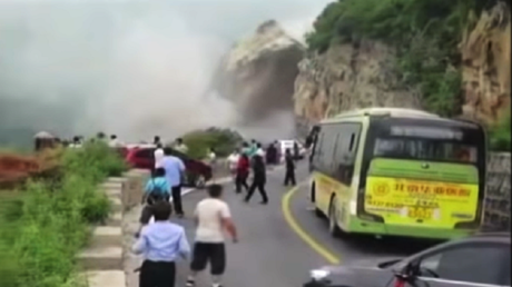 'Not a hero, that's just my job': Chinese man stops traffic as huge landslide hits road (VIDEO)