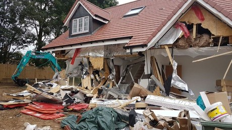 Builder uses digger to destroy row of houses after 'not being paid' (PHOTOS)