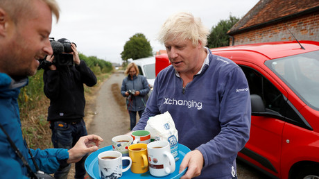 'Treating you like mugs': Twitter blasts 'fawning' reporters who fell for Boris Johnson's tea stunt