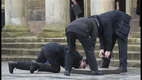 FILE PHOTO. Police perform a search of drains outside of Salisbury Guildhall ahead of the visit of the UK PM Theresa May. © Ben Stevens