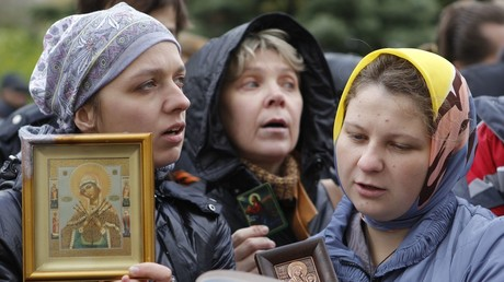 Russian Orthodox believers gather outside a court building during the trial of jailed members of the female punk band