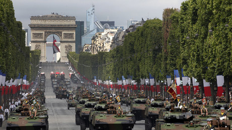 Tanks rumble down the Champs Elysee avenue during the traditional Bastille Day military parade in Paris, France