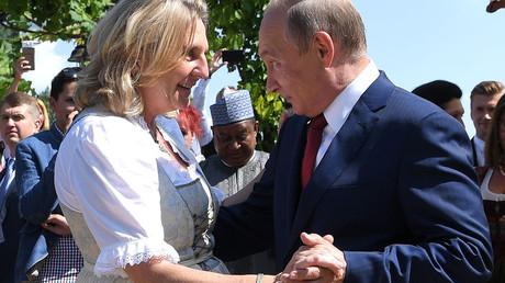 Austrian FM Karin Kneissl faints in public shortly after being grilled on Putin wedding invitation