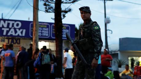 A Brazilian soldier patrols Pacaraima border control in Roraima state, Brazil © Nacho Doce