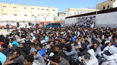 FILE PHOTO:  Migrants are seen at a reception center in Tripoli, Libya, on February 22, 2018. © Hamza Turkia