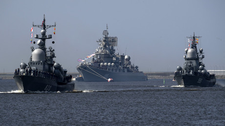 "The missile cruiser ""Marshal Ustinov"" (center) during a parade. © Aleksandr Galperin"