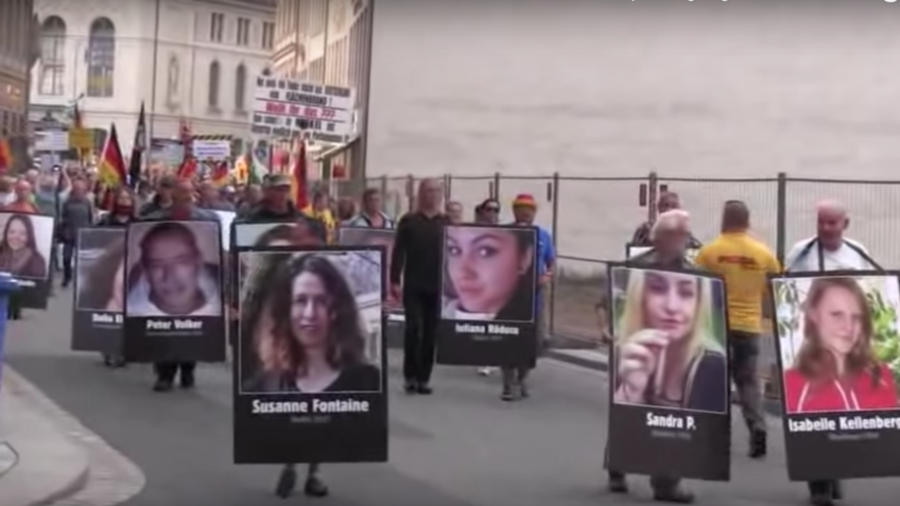 PEGIDA demonstrators march with photos of victims 'killed by foreigners' in Germany (VIDEO)