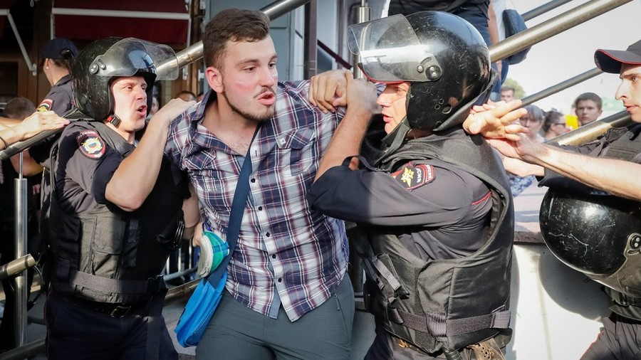 Putin press secretary backs police action against 'provocative hooligans'
