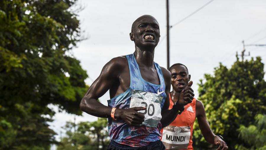 Kenyan runner Joseph Kiprono hit by car while leading half marathon in Colombia