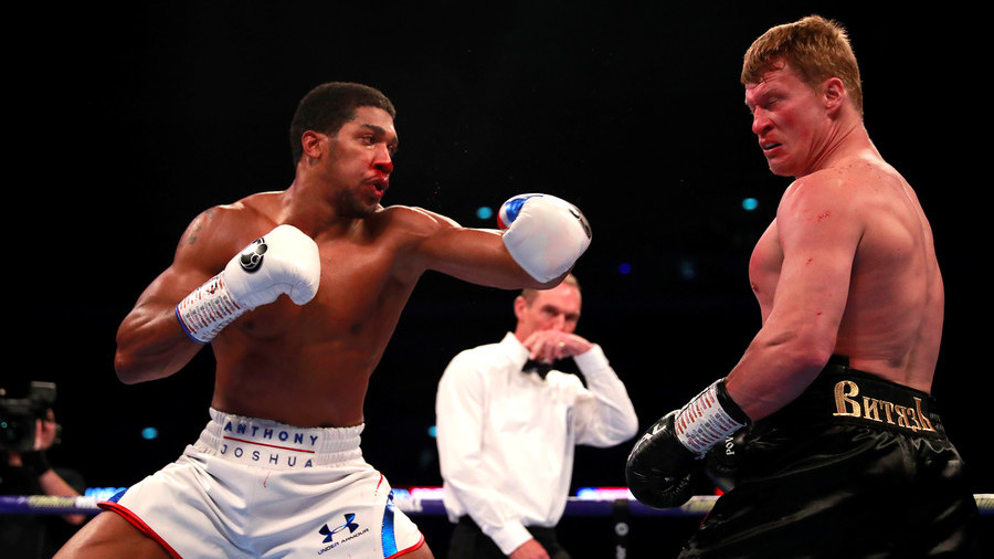 Anthony Joshua KOs Alexander Povetkin in thriller to retain world heavyweight titles