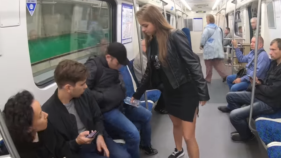 Woman splashes bleach on men's crotches in protest against manspreading
