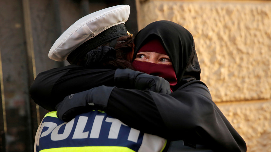 Denmark investigating policewoman who hugged niqab-wearing protester