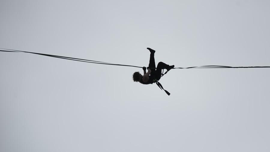Nerve-racking: Tightrope walker thrills onlookers in St. Petersburg amid stormy winds