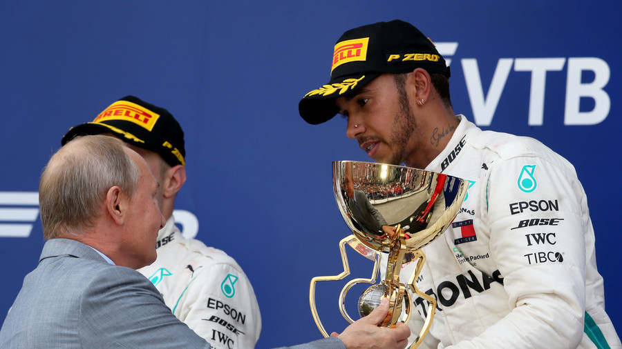 'I won't spray you with champagne this time': Hamilton & Putin share joke at Russian Grand Prix