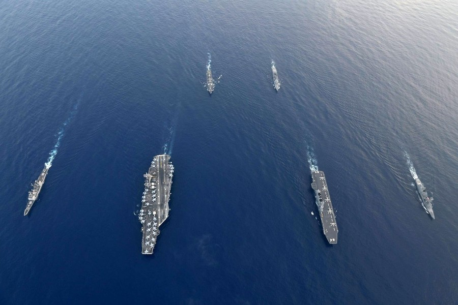 Japan's largest warship trains with US naval strike group in contested South China Sea