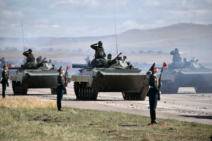 Vladimir Putin inspects war games, vows to beef up army