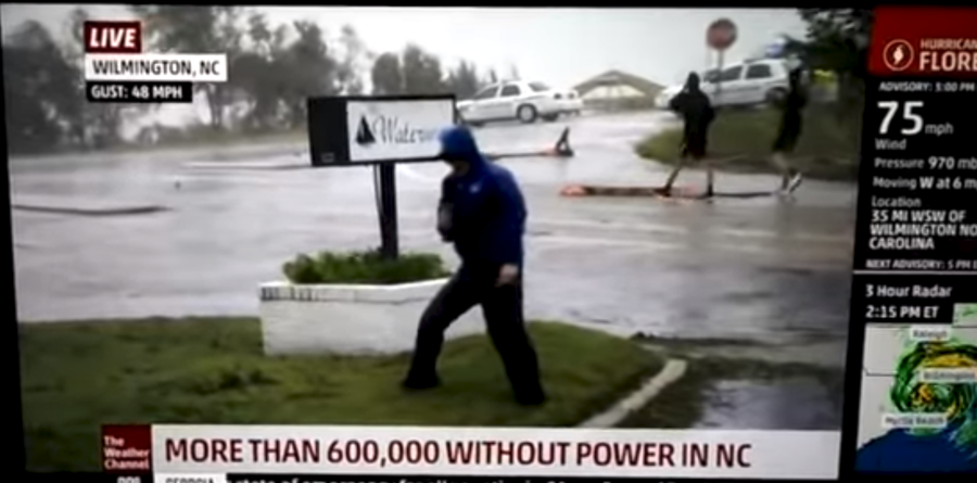 Hang in there! Weather anchor dramatically braces against Hurricane Florence winds (VIDEO)