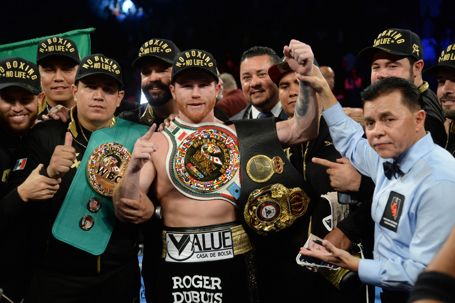 Canelo takes middleweight titles, hands Golovkin 1st career defeat in thrilling rematch