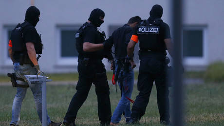 FILE PHOTO German police arresting suspect. © Raplh Orlowski