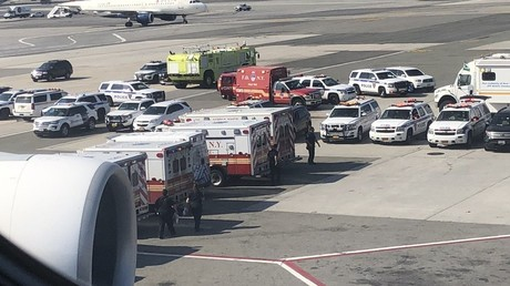 Counter-terror police 'monitoring' Emirates plane at JFK as 100 people reportedly fall ill (PHOTOS)