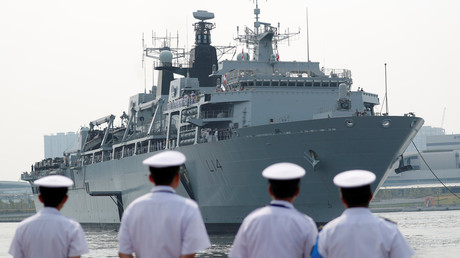China escorts British assault ship on 'freedom of navigation' voyage through South China Sea