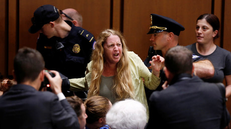 Paid protesters at Kavanaugh hearings? Twitter abuzz after photo shows activist receiving cash
