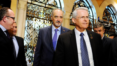 U.S. Senator Richard Black walks with Syrian government negotiator Bashar Ja'afari (C), Damascus, Syria April 28, 2016. REUTERS/Omar Sanadiki