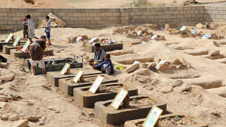Yemenis grieve beside the grave of a child killed in last month's coalition airstrike on a school bus © Naif Rahma