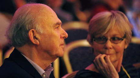 Vince Cable and wife Rachel Smith listen to a speech at the Liberal Democrats conference in Brighton. March 10, 2013. © Luke MacGregor