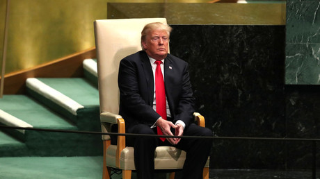 US President Donald Trump sits in the chair reserved for heads of state before delivering his address during the 73rd session of the United Nations General Assembly at UN headquarters in New York, U.S., September 25, 2018. В© Carlo Allegri